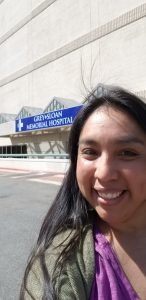 Selfie in front of the Grey + Sloan Memorial Hospital signage